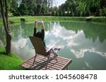 young woman sitting on chair... | Shutterstock . vector #1045608478