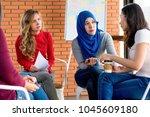 diverse women sharing problems... | Shutterstock . vector #1045609180