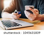 online payment young man's... | Shutterstock . vector #1045631839