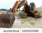 yellow powerful excavator on a...   Shutterstock . vector #1045633480