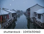 a small snowy town | Shutterstock . vector #1045650460