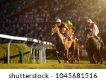 Stock photo two jockeys during horse races on his horses going towards finish line traditional european sport 1045681516