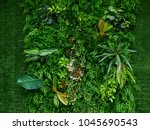 artificial green plant wall | Shutterstock . vector #1045690543