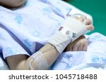 sick child on a receiving a... | Shutterstock . vector #1045718488