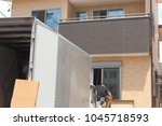 newly built houses and moving... | Shutterstock . vector #1045718593