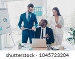 three thoughtful  stylish ... | Shutterstock . vector #1045723204