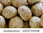freshly baked buns with grains... | Shutterstock . vector #1045723948