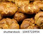 freshly baked rolls with grains ... | Shutterstock . vector #1045723954