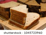 cut pieces of bread of... | Shutterstock . vector #1045723960