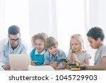 primary school genius kids... | Shutterstock . vector #1045729903