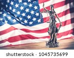 lady justice and american flag... | Shutterstock . vector #1045735699
