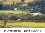 View in Ettrick Valley  in the Border country of Scotland, with historic Hunting Lodge and other farm buildings in the river valley