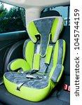 child seat in car | Shutterstock . vector #1045744159