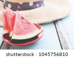 pieces of watermelon on rustic... | Shutterstock . vector #1045756810