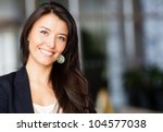 friendly business woman smiling ... | Shutterstock . vector #104577038