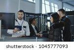 diverse employees of airport... | Shutterstock . vector #1045777093