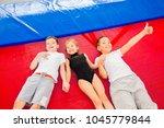 family in trampoline center | Shutterstock . vector #1045779844