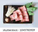 japanese raw kobe beef on black ... | Shutterstock . vector #1045783909