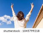 beautiful young woman making... | Shutterstock . vector #1045799218