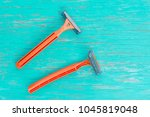 razor on wood background. | Shutterstock . vector #1045819048