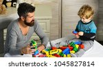 dad and kid build of plastic... | Shutterstock . vector #1045827814