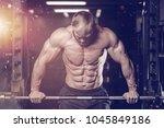 brutal muscular man with beard... | Shutterstock . vector #1045849186