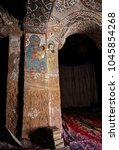 Small photo of TIGRAY REGION, ETHIOPIA – February 10, 2018: wall murals of saints and iconographic scenes, painted in naive african christian style, on wall of Abuna Yemata Guh church