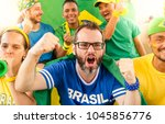 Stock photo group of happy brazilian soccer fans and friends at stadium brazil 1045856776
