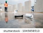epoxy floor in warehouse... | Shutterstock . vector #1045858513