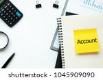 Small photo of Top view white backgorund desktop with yellow note write text Account for Accounting concept.Selective focus.