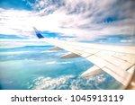 looking through window aircraft ... | Shutterstock . vector #1045913119