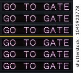 Small photo of Airport departure board with go to gate sign.