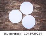 blank white paper on wooden... | Shutterstock . vector #1045939294