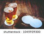 beer in glass on old wooden... | Shutterstock . vector #1045939300