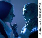woman and an alien look at each ...   Shutterstock . vector #1045941730