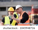construction workers at work on ... | Shutterstock . vector #1045948726