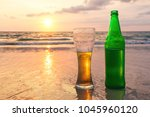 misted glass and bottle of cold ... | Shutterstock . vector #1045960120