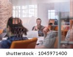 startup business  young... | Shutterstock . vector #1045971400