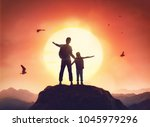 kid and dad look at sunset.... | Shutterstock . vector #1045979296