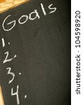 A list of goals numbered on a chalkboard for the successful mindset. - stock photo