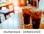 two glass soft drink with ice... | Shutterstock . vector #1046011423