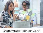 two business women discussing...   Shutterstock . vector #1046049370