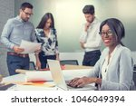 smiling business woman working...   Shutterstock . vector #1046049394