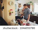 happy couple cooking in kitchen.... | Shutterstock . vector #1046053780