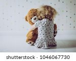 little curly haired girl crying ... | Shutterstock . vector #1046067730
