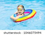 child with goggles in swimming... | Shutterstock . vector #1046075494