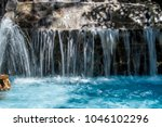 A Waterfall Of A Fountain In A...