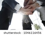 business people folding their... | Shutterstock . vector #1046116456