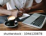 freelancer writing notes... | Shutterstock . vector #1046120878