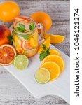 citrus fruit and herbs water... | Shutterstock . vector #1046121274